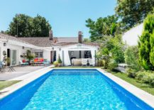Mediterranean-pool-house-in-white-with-terra-cotta-tiles-brings-home-the-holidays-217x155