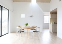 Minimal-dining-room-in-white-and-wood-with-skylight-217x155