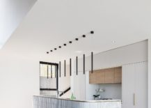 Minimal-kitchen-with-curved-island-that-is-a-showstopper-217x155