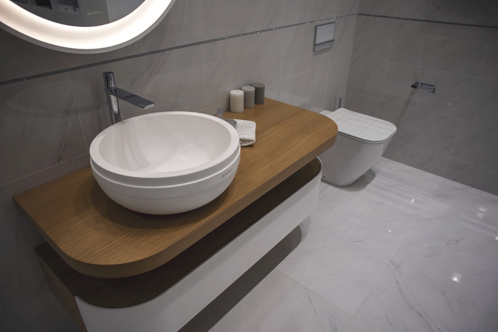 Modern bathroom with curvy vanities and wash basin