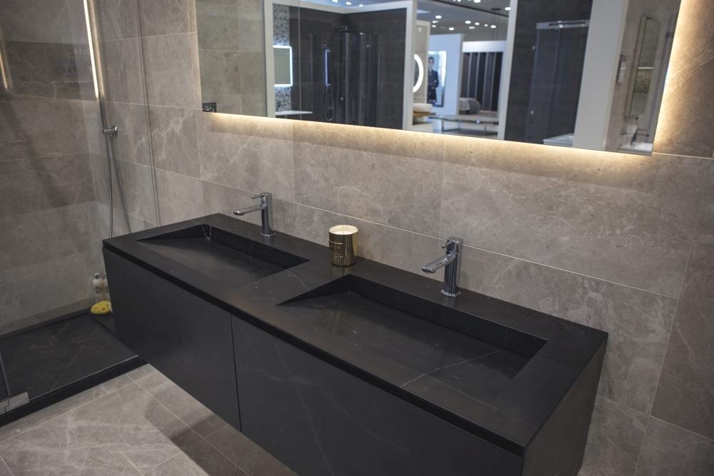 Modern dark stone vanities with glossy bathroom tiles