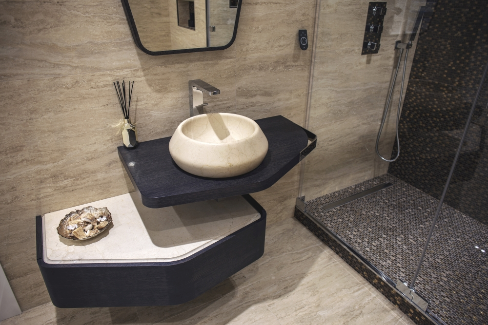 Natural stone bathroom by Porcelanosa