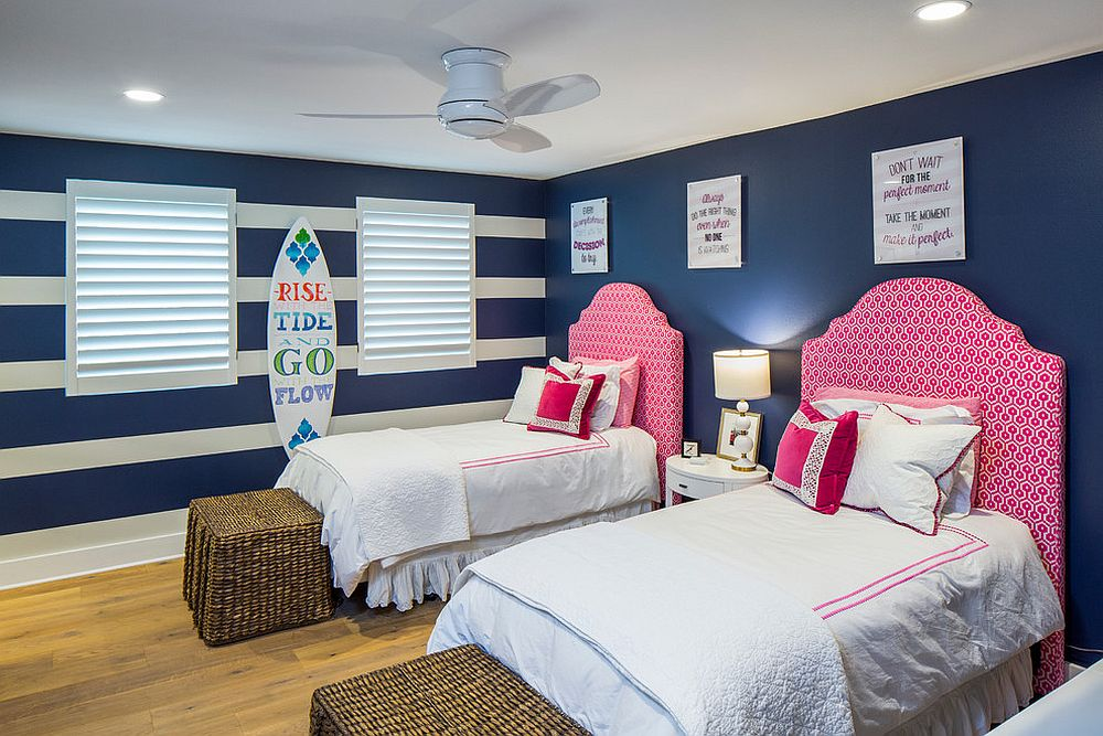 Navy blue coupled with pops of pink in the kids' room