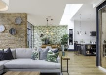 Open-plan-lower-level-living-area-of-Tactile-House-in-Dulwich-England-217x155
