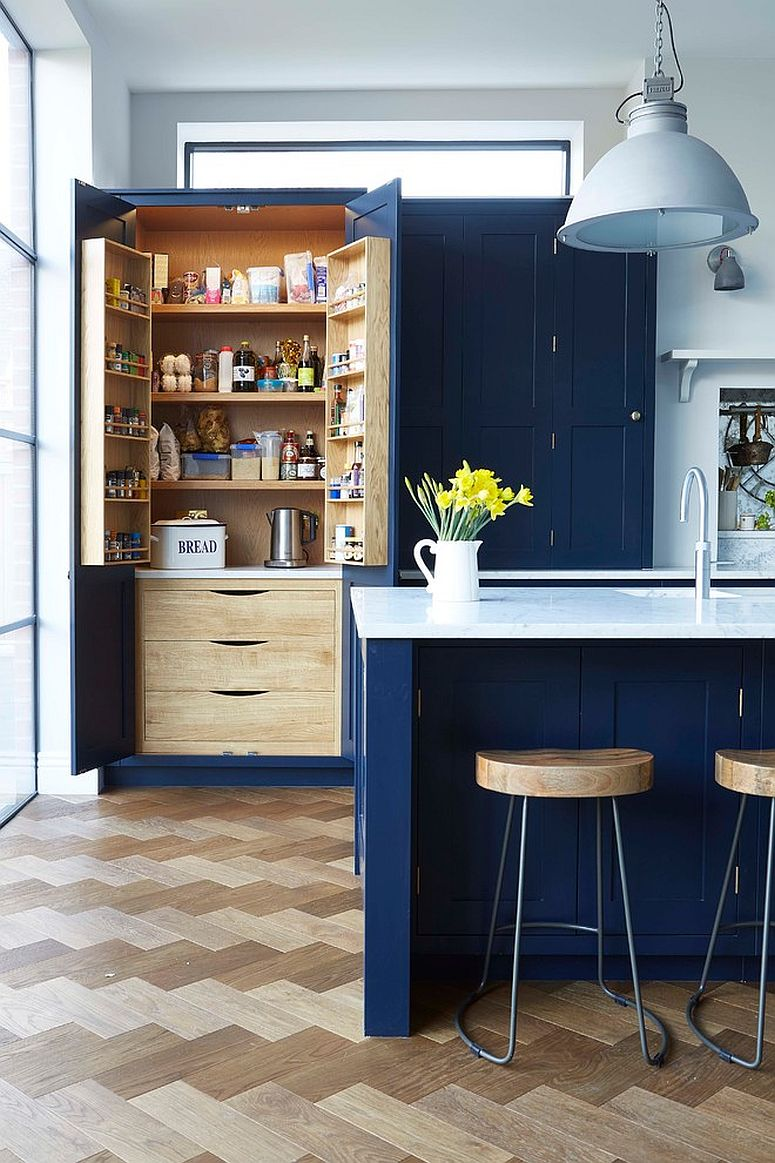 Pantry doors in blue offer additional storage space