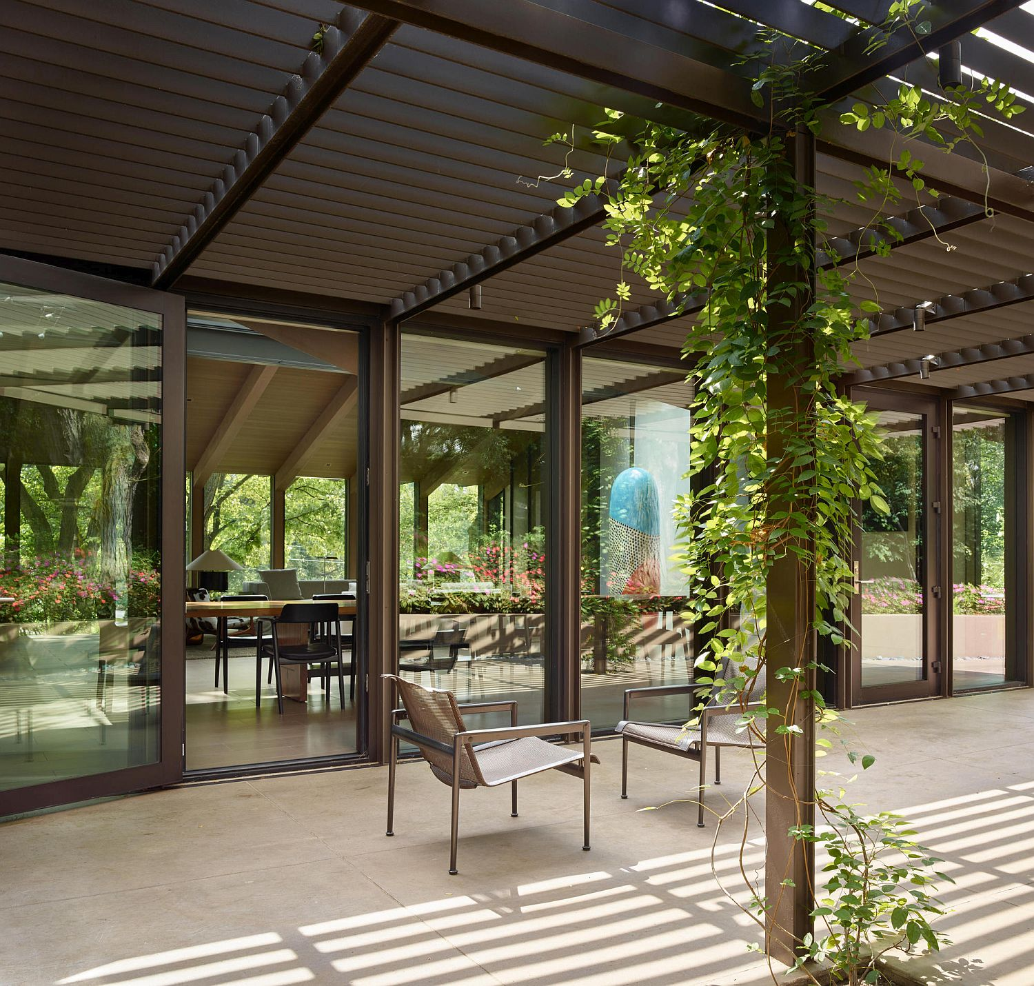 Pergola outside the Omaha home with outdoor sitting area