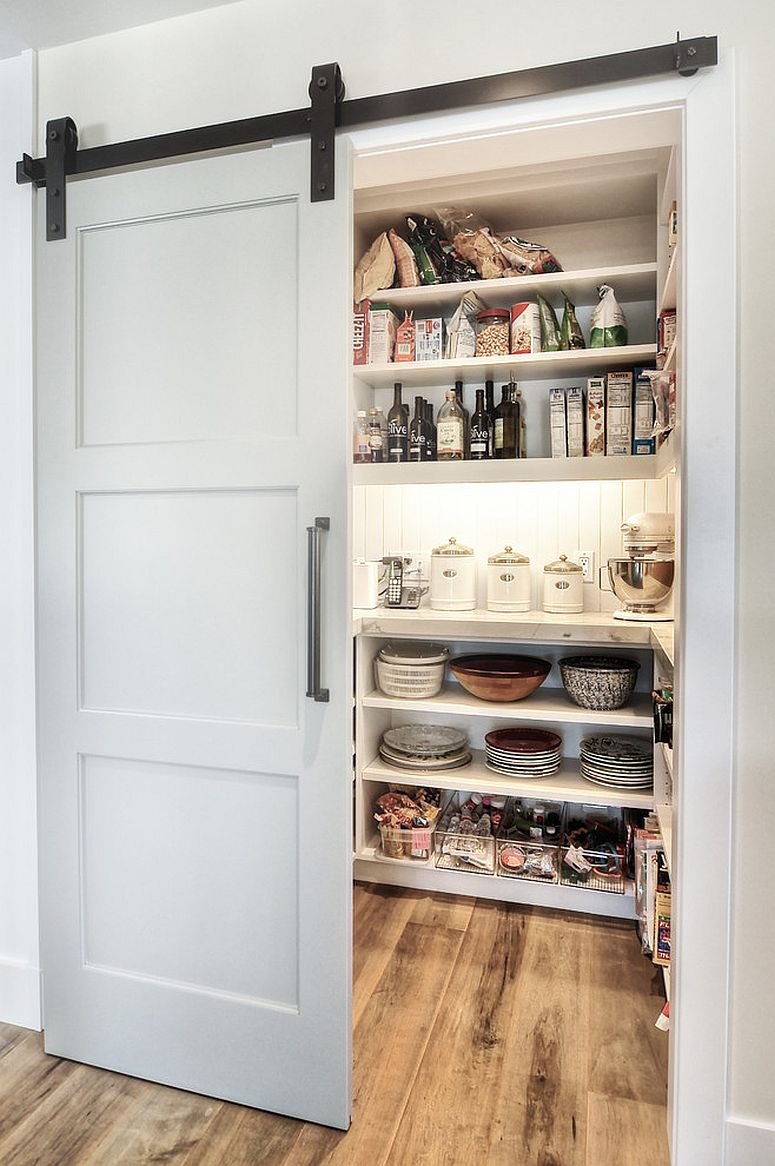 Sliding barn style door for the small kitchen pantry