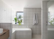 Small-tiles-in-white-give-the-bathroom-a-more-classic-appeal-217x155