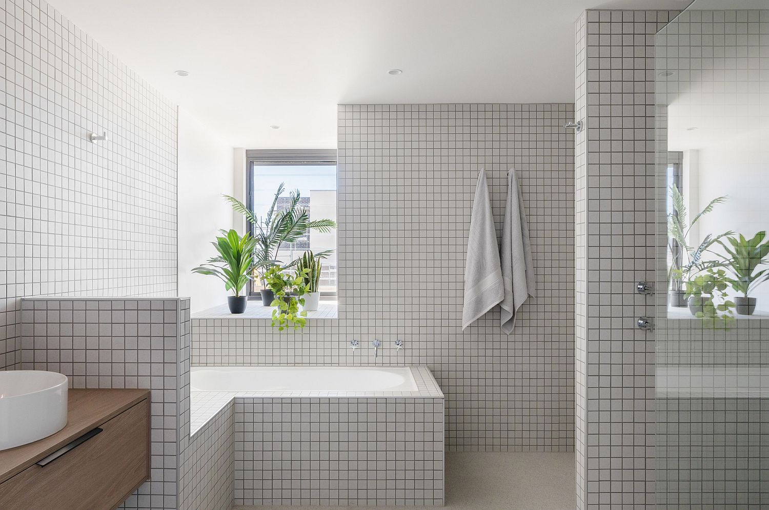 Small tiles in white give the bathroom a more classic appeal