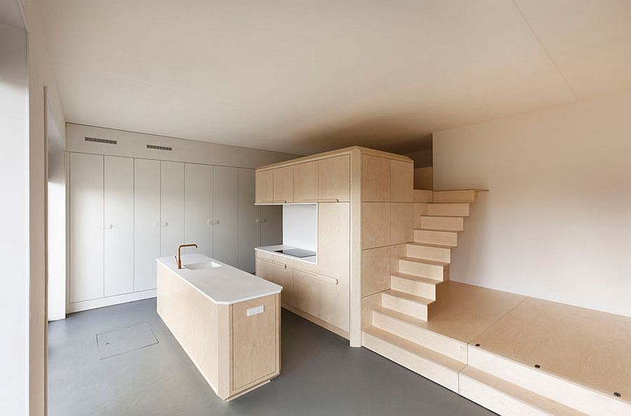 Staircase leads to the small loft level bed above the bathroom and closet