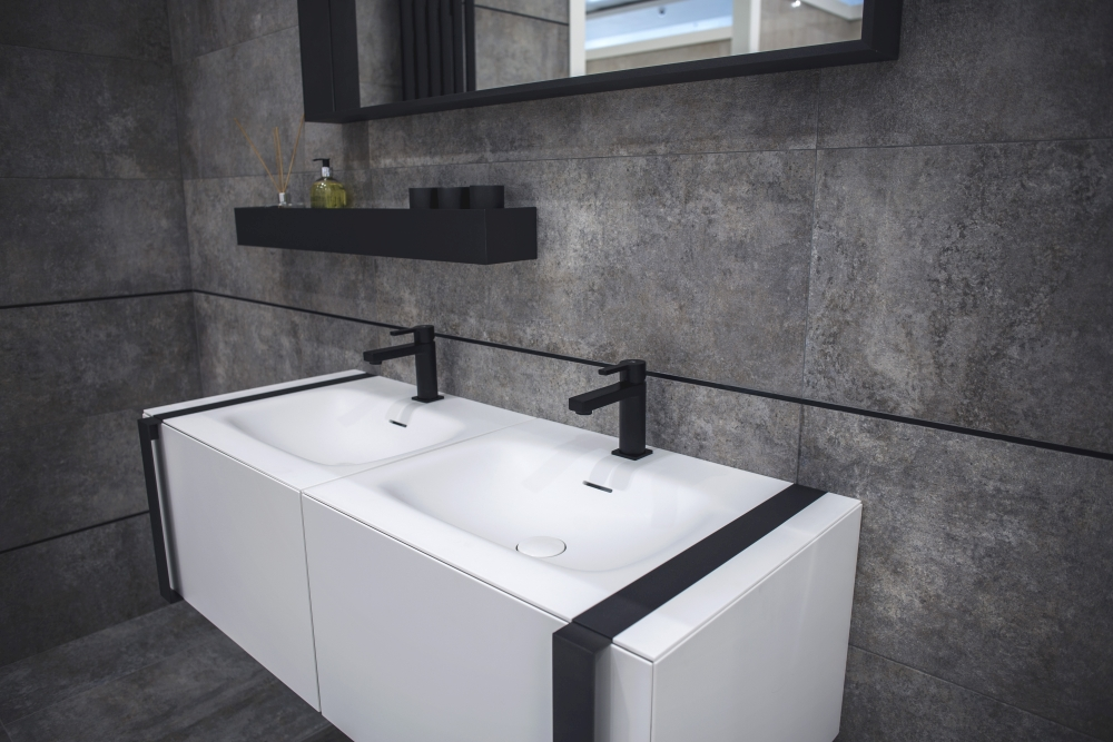 Stone like ceramic tiles and white vanity with white KRION Bath washbasin