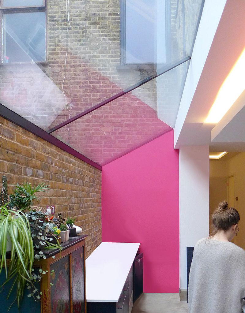 Touch of pink coupled with brick and glass in the kitchen