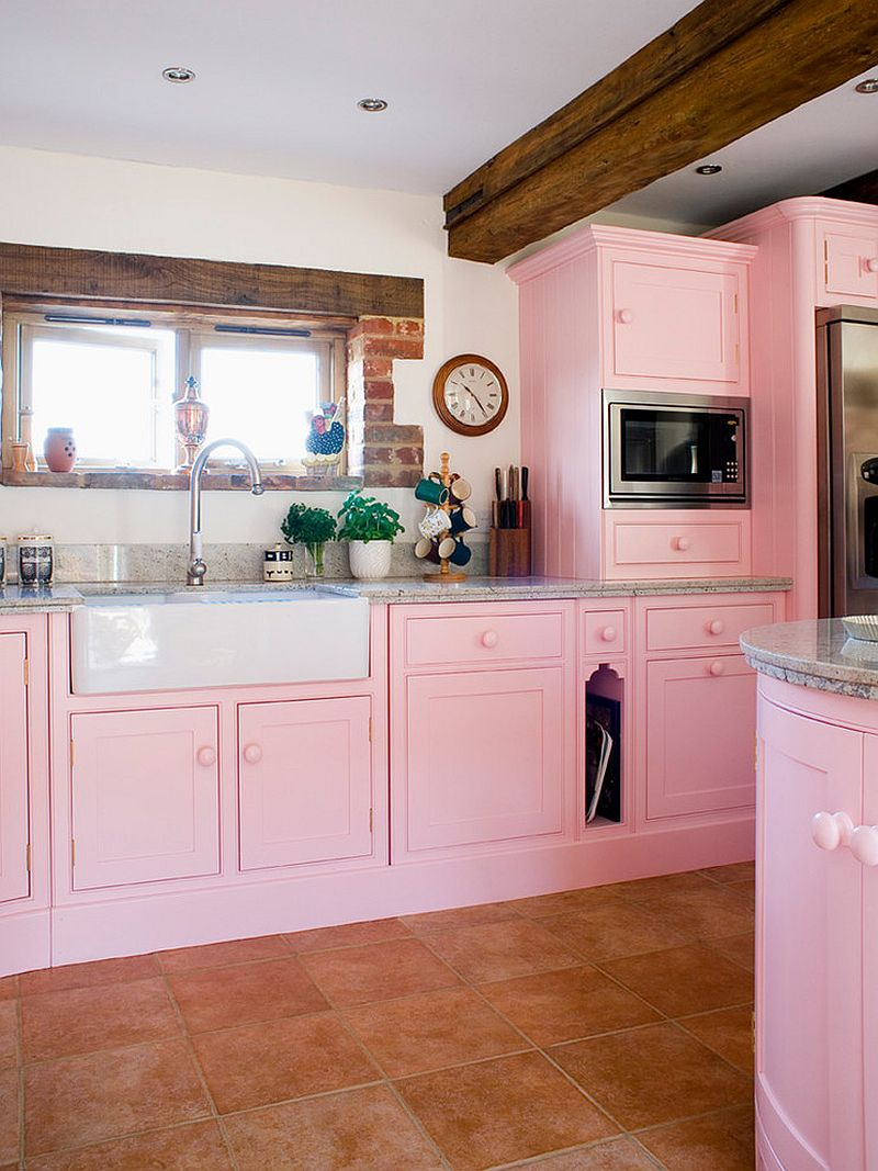 Traditional kitchen in pink with wooden ceiling beams
