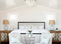 Using-bedside-tables-to-usher-in-wooden-element-into-the-white-bedroom-217x155