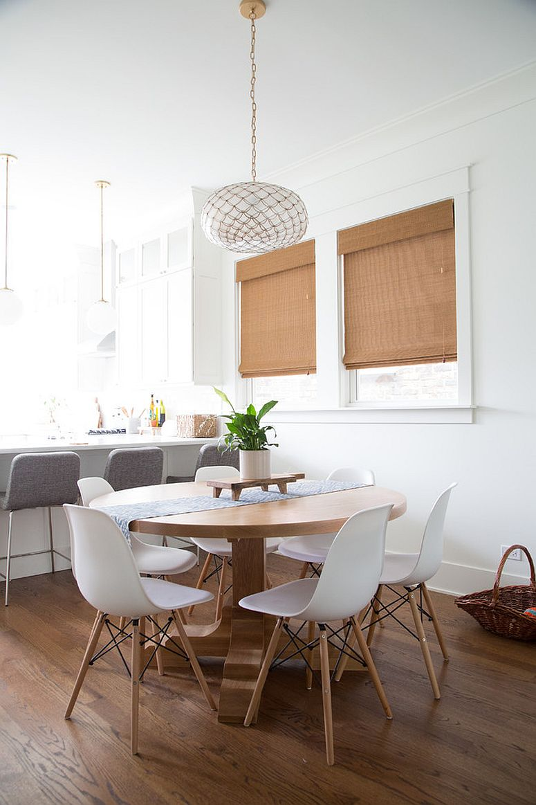 White, light and wood shape this gorgeous dining space