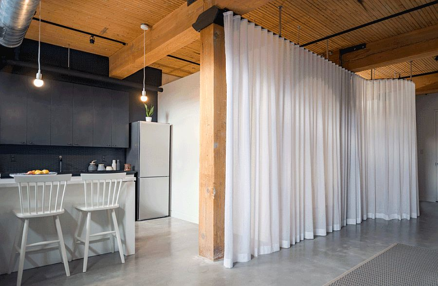 White sheer curtains hide the bed box