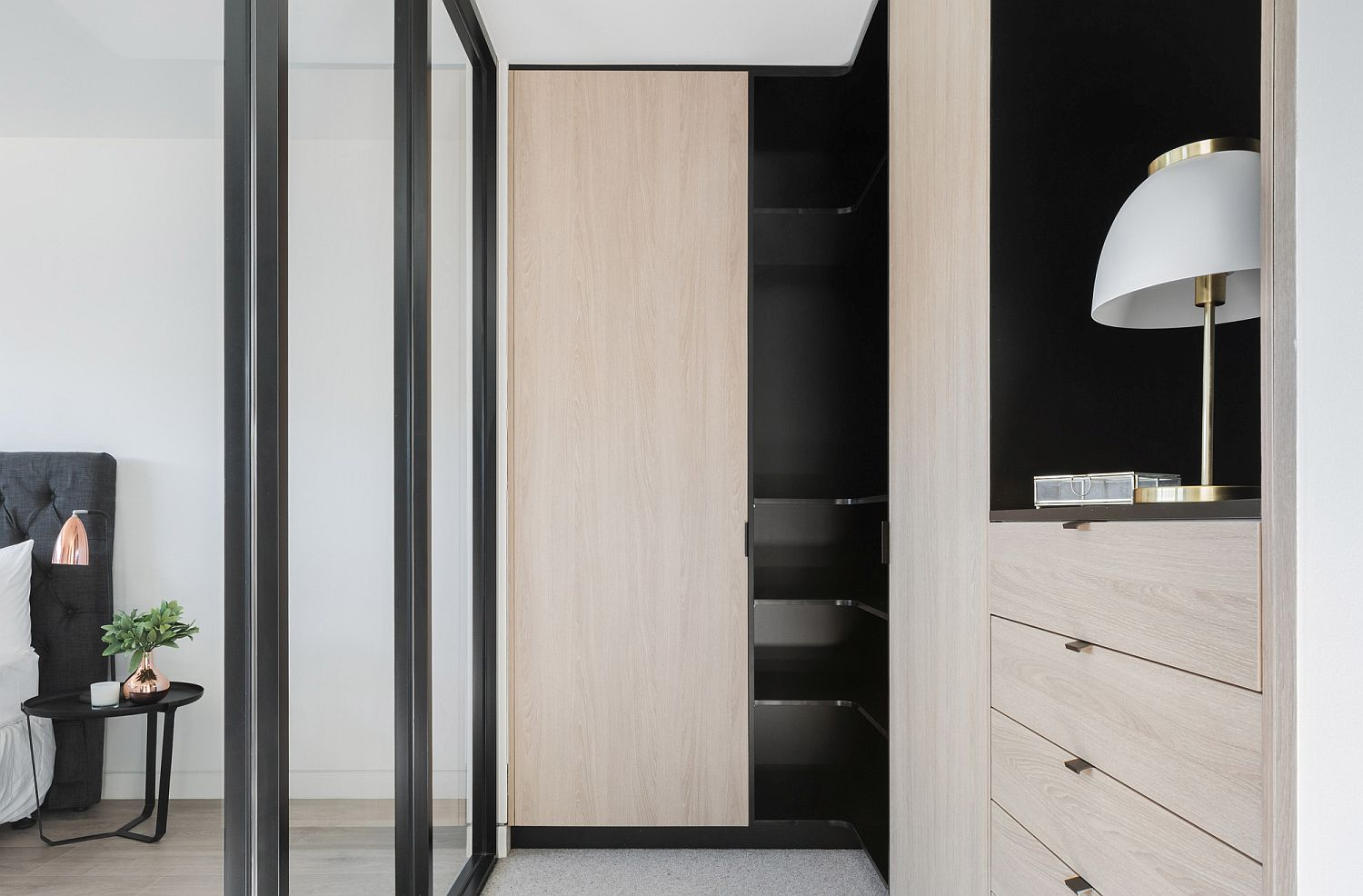 Wood-and-black-add-contrast-to-the-white-interior