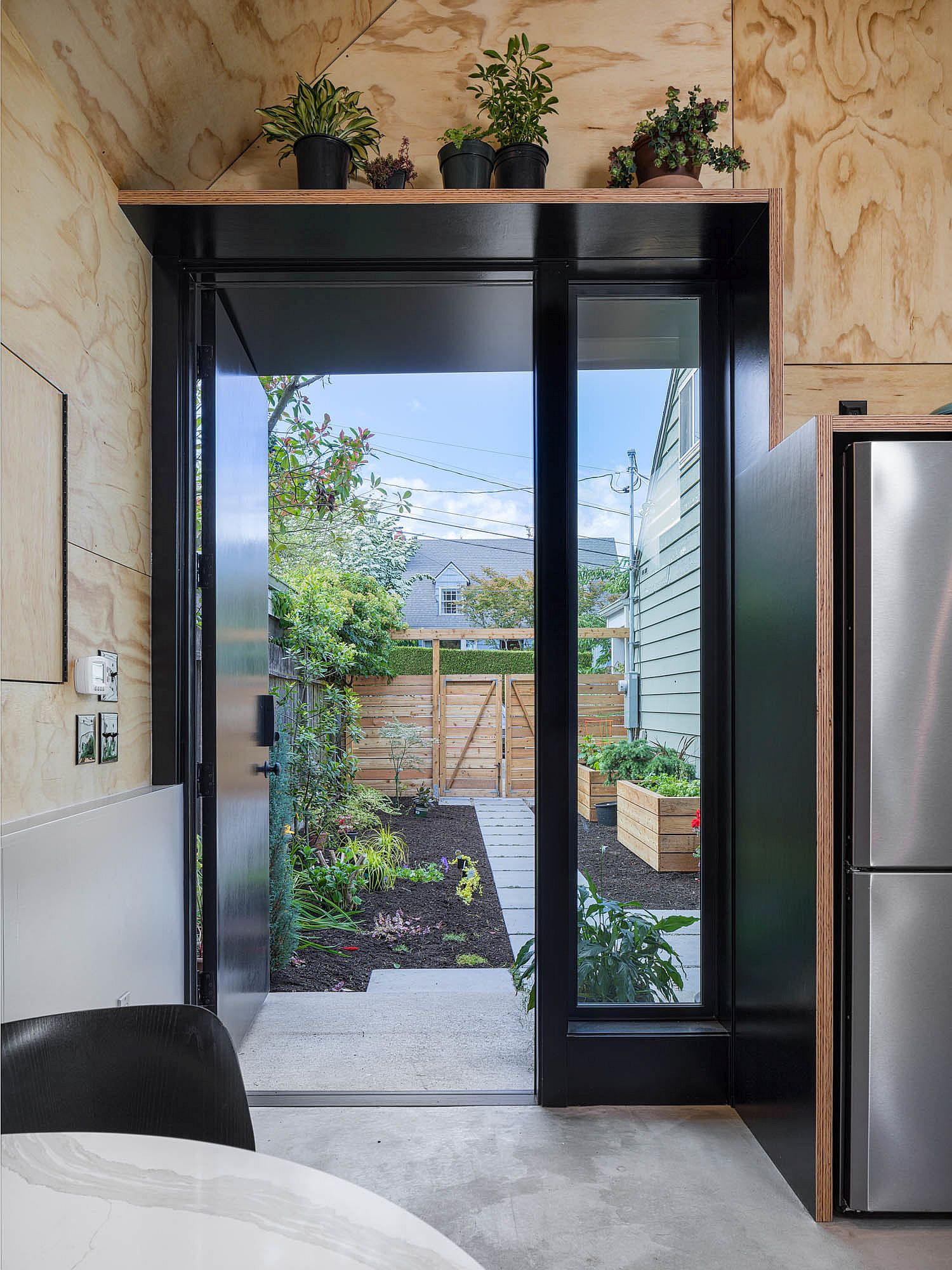 Wood and black interior of the tiny backyard home