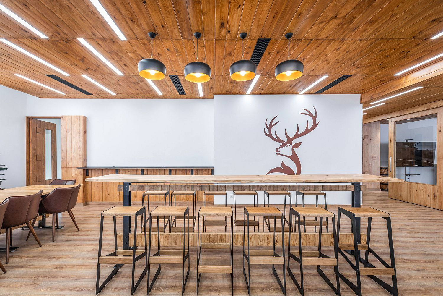 Wooden ceiling and floor give the office a warm inviting look