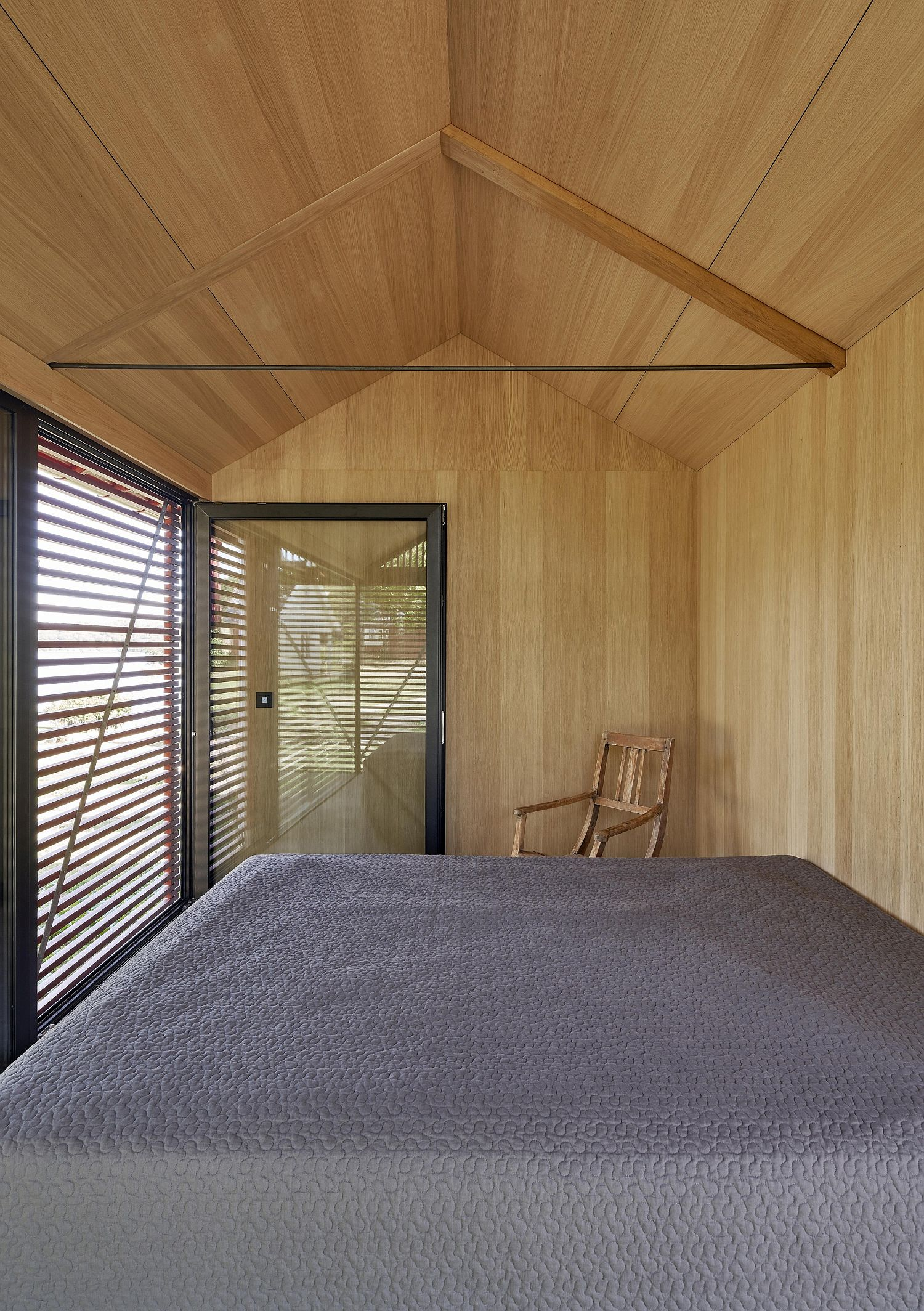 Woodsy bedroom of the cabin is protected from the elements