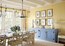 Yellow-accent-wall-and-blue-credenza-for-the-smart-beach-style-dining-room-217x155