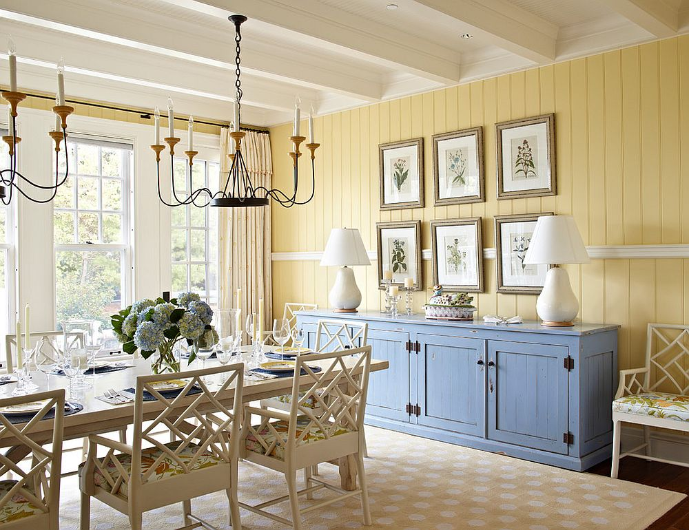 Yellow accent wall and blue credenza for the smart beach style dining room