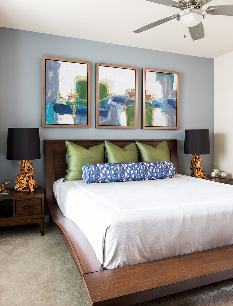 Add color to the headboard wall with selected works of art