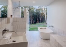All-white-bathroom-connected-to-the-garden-outside-217x155