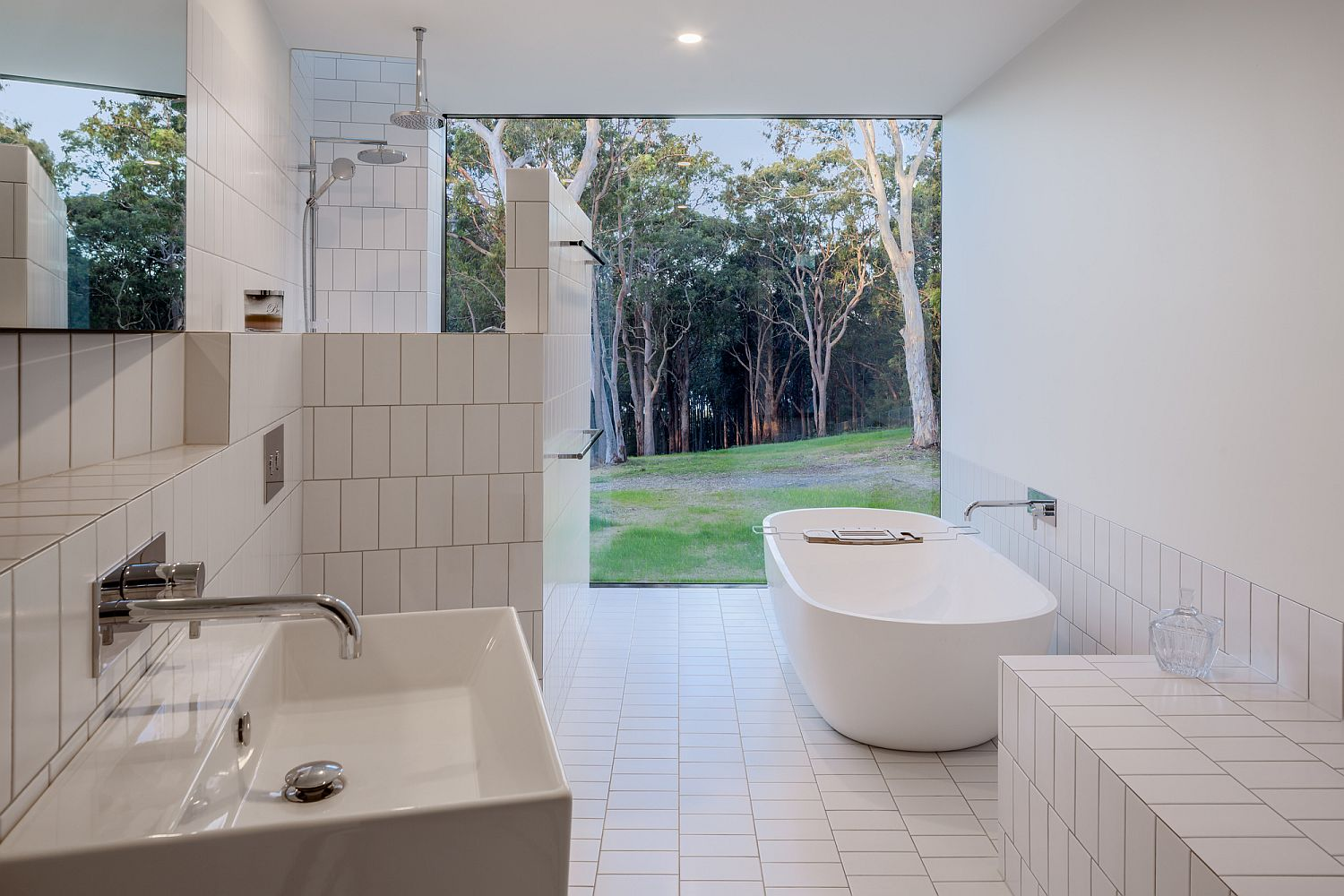 All-white bathroom connected to the garden outside