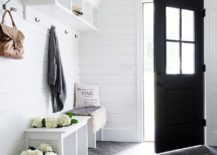 All-white-mudroom-with-a-dark-door-leading-way-217x155