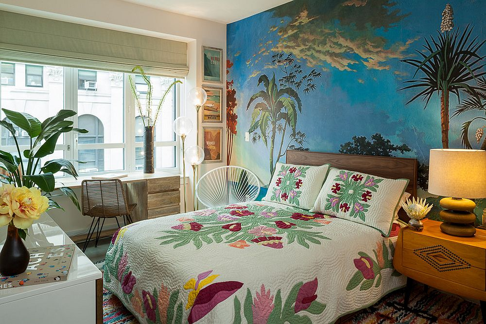 Beautiful wall mural and bedding bring color to this tropical style bedroom