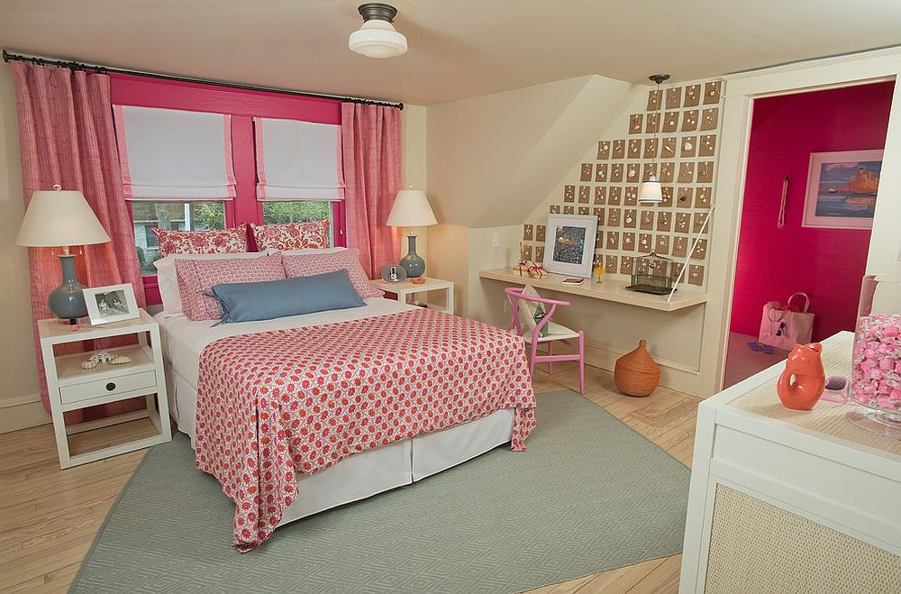 Bedding, drapes and decor add pink to this bedroom
