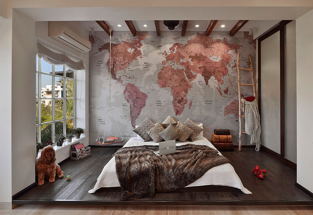 Bedroom of bachelor pad with world map as its backdrop