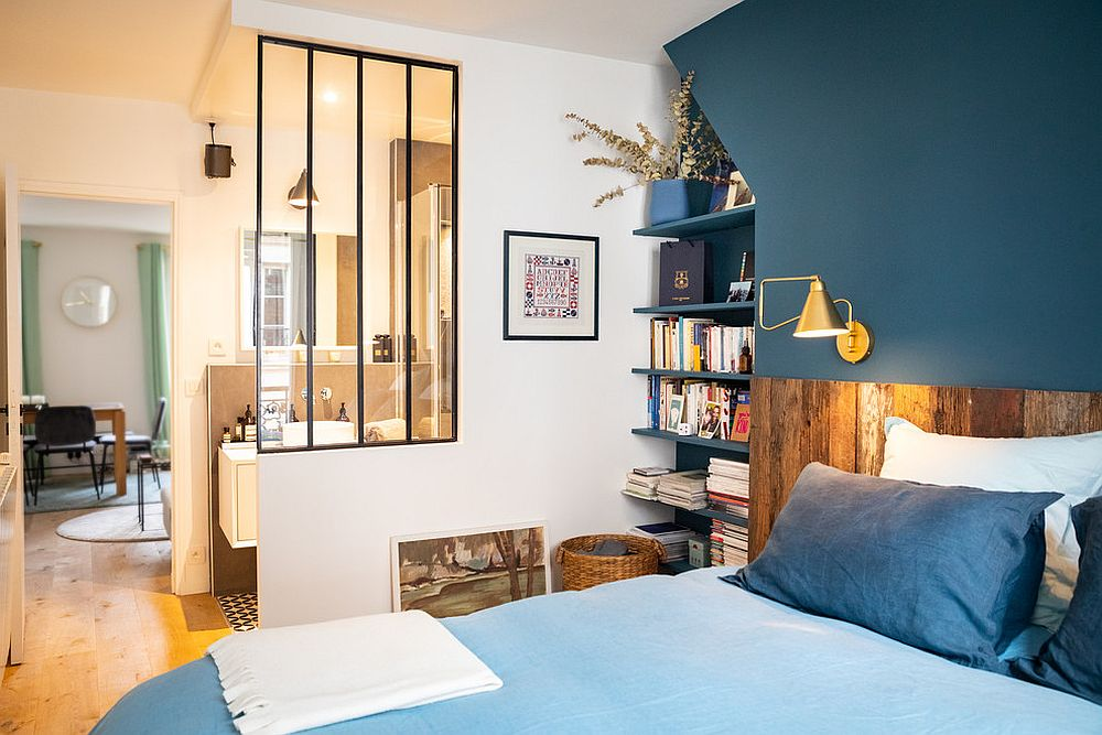 Bluish-gray is a trendy color to choose for the accent wall in the bedroom