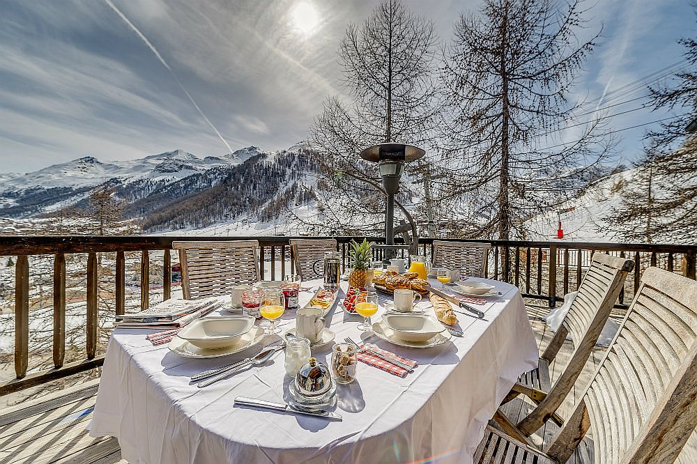 Breathtaking view of Val d'Isère and the snow-covered Alps from the terrace of the chalet