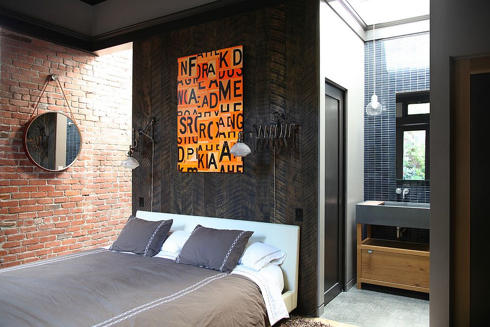 Colorful art addition enliens this Industrial bedroom