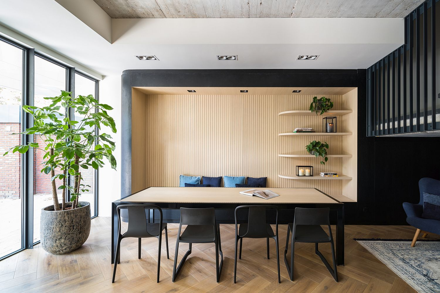 Concrete, wood and dark backdrop gives the apartments an urbane sophistication