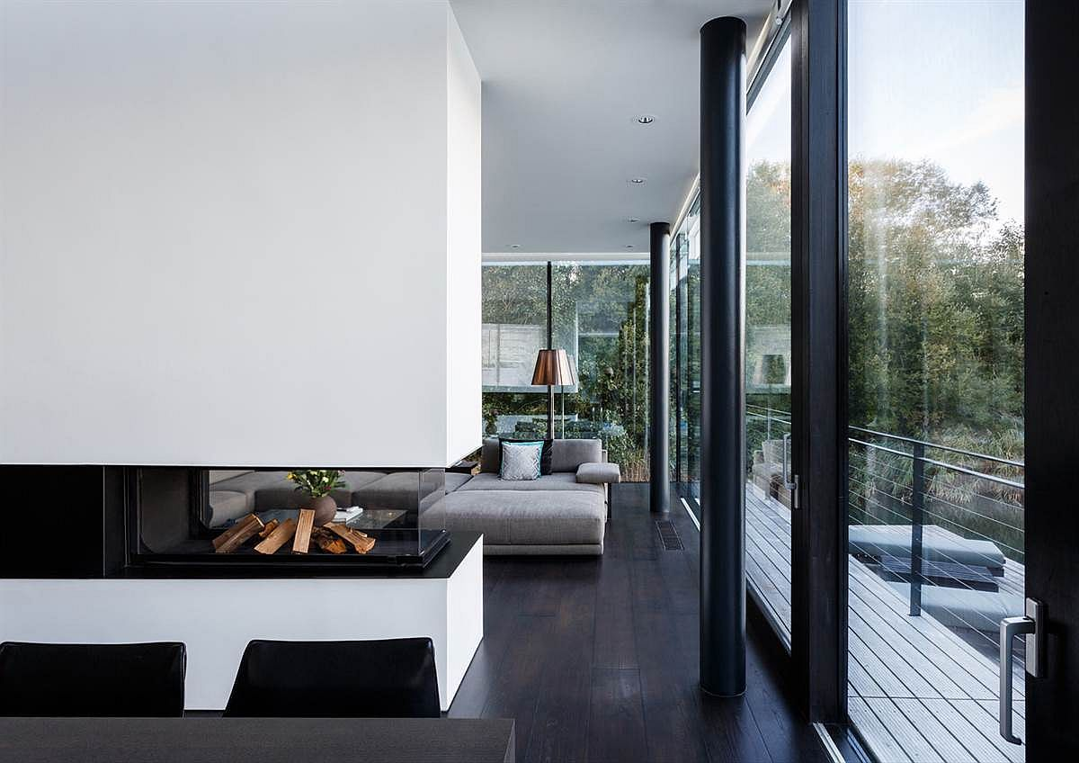Contemporary interiors of the lake house with white and steel palette