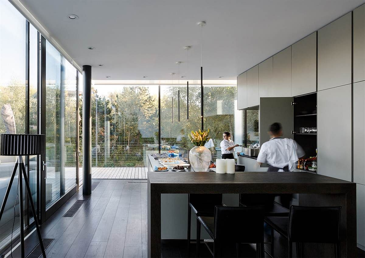 Contemporary kitchen of the Glass Villa on a Lake