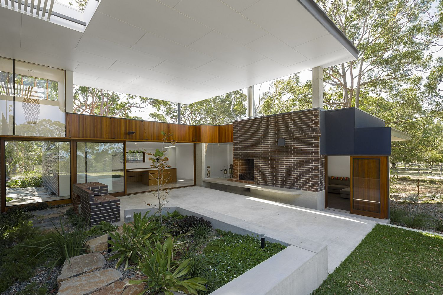Covered exterior spaces flow into the natural landscape outside