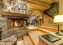 Cozy-stone-fireplace-in-the-large-living-area-that-can-accomodate-15-guests-with-ease-217x155