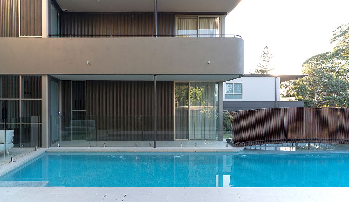 Curved balconies and design of the bridge give the home a polished contemporary look