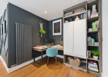 Dark-gray-home-office-with-corner-desk-in-wood-and-custom-shelving-217x155