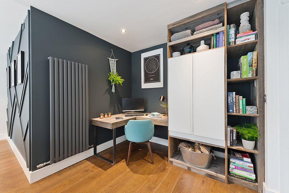 Dark gray home office with corner desk in wood and custom shelving
