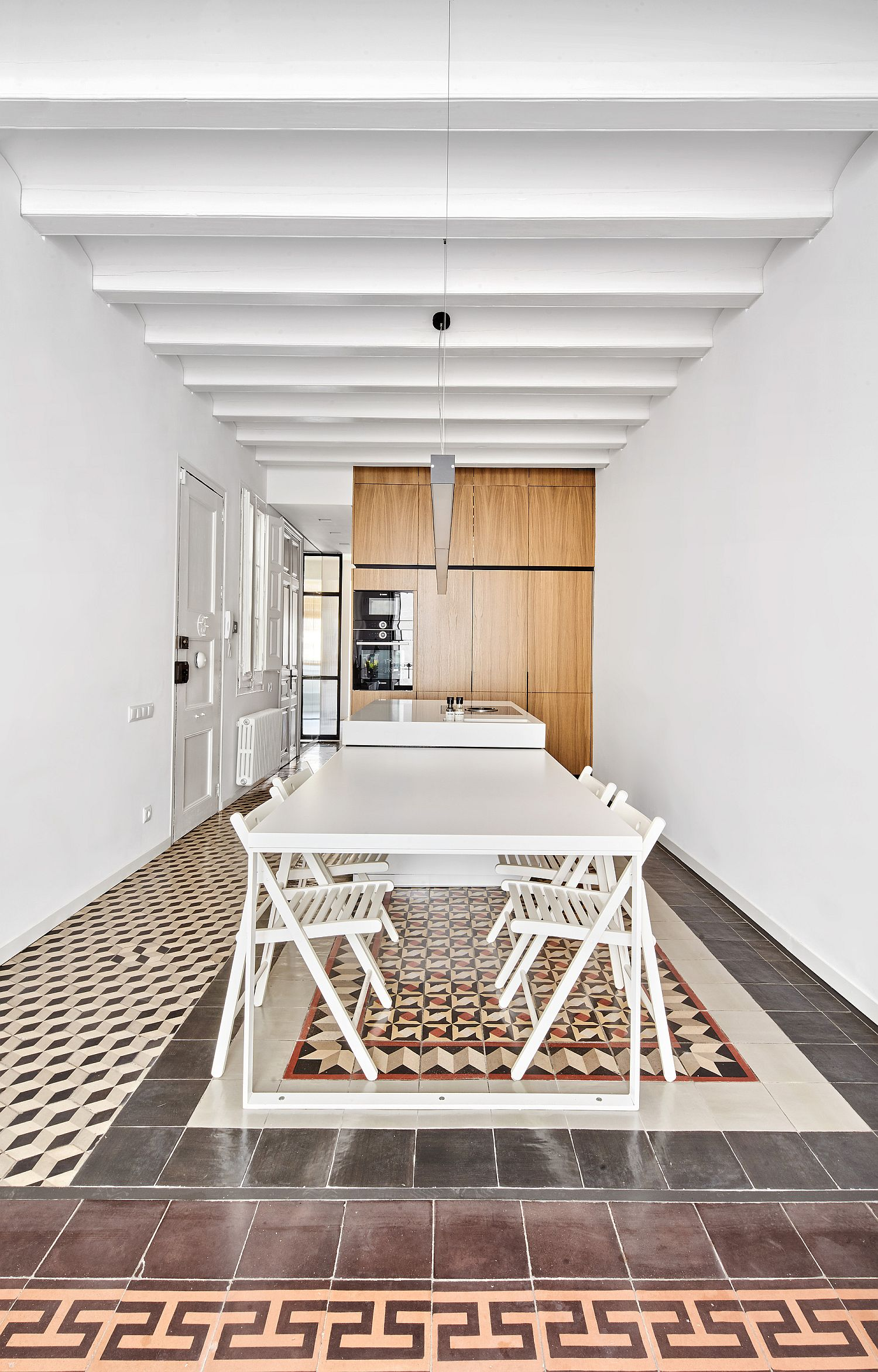Dining area and kitchen of the revamped Barcelona apartment