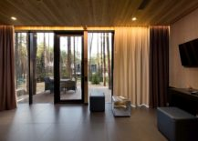 Drapes-heated-floors-and-woodsy-interior-provide-a-cozy-living-space-217x155
