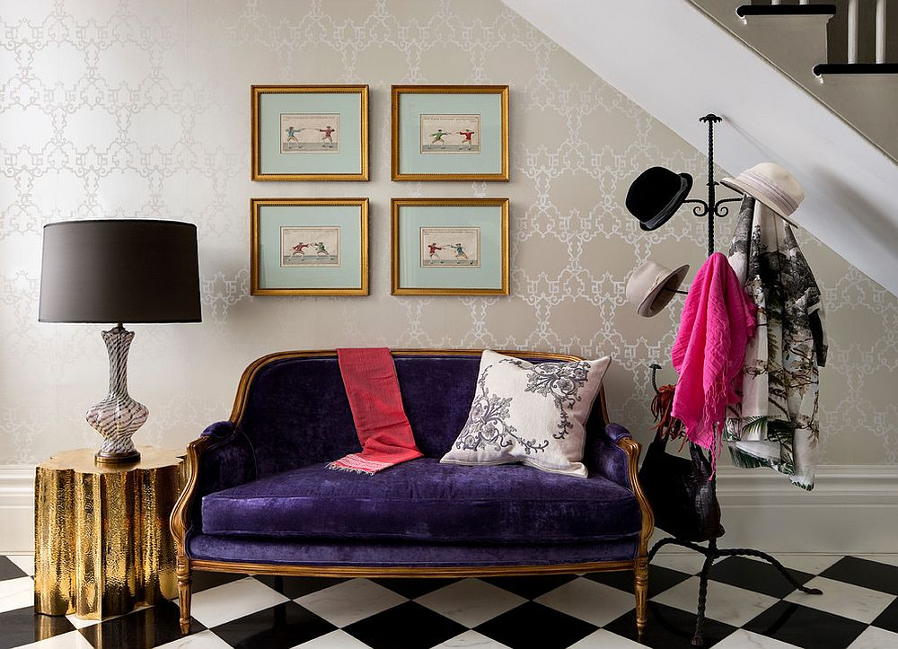 Exquisite entry with wallpapered backdrop, hats hanger and pops of gold and purple