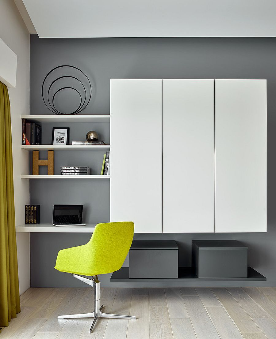Exquisite minimal home office in gray with wall storage system