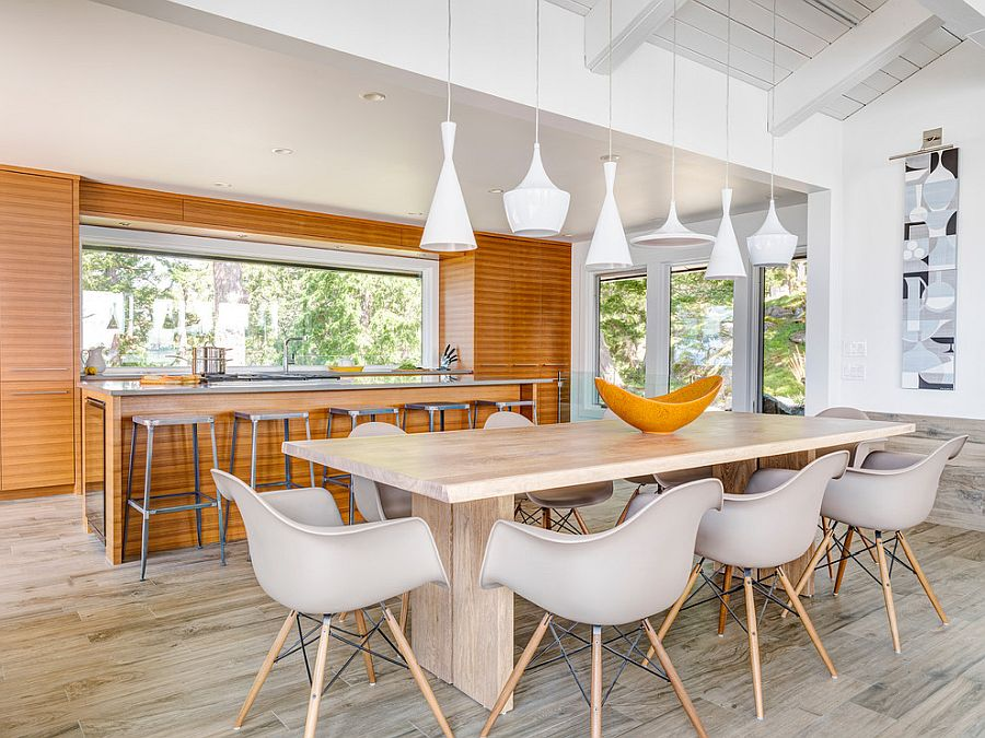 Geometric contrast takes over with lighting fixtures in this dining space