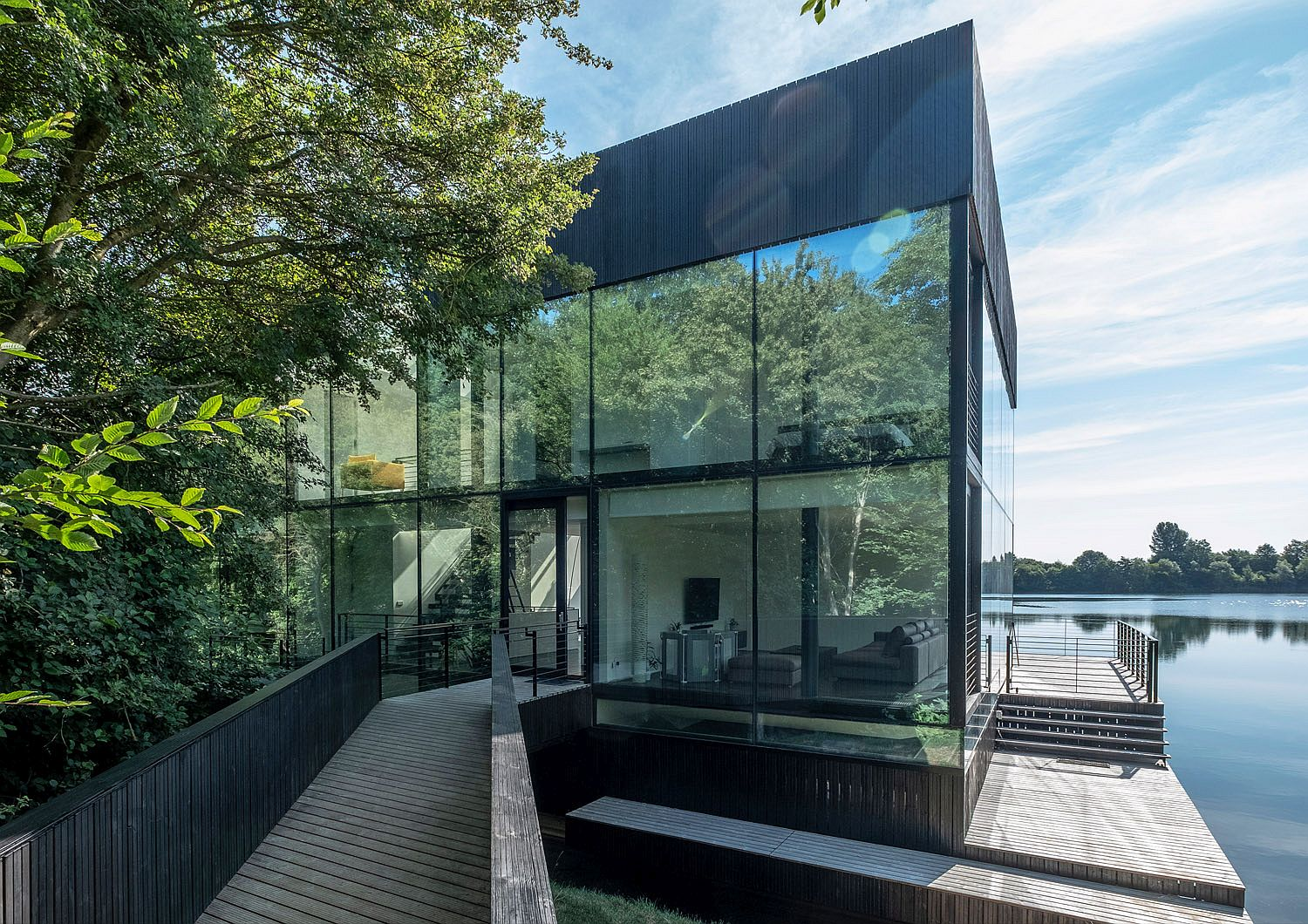Glass House on the edge of a lake in England